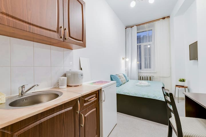 Cozy room with kitchen in the center