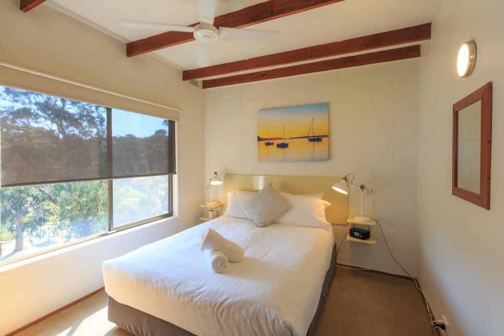 Main bedroom with a very comfortable queen bed and hotel quality linen to ensure a good sleep