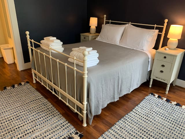 Queen bed with 100% cotton bedding.