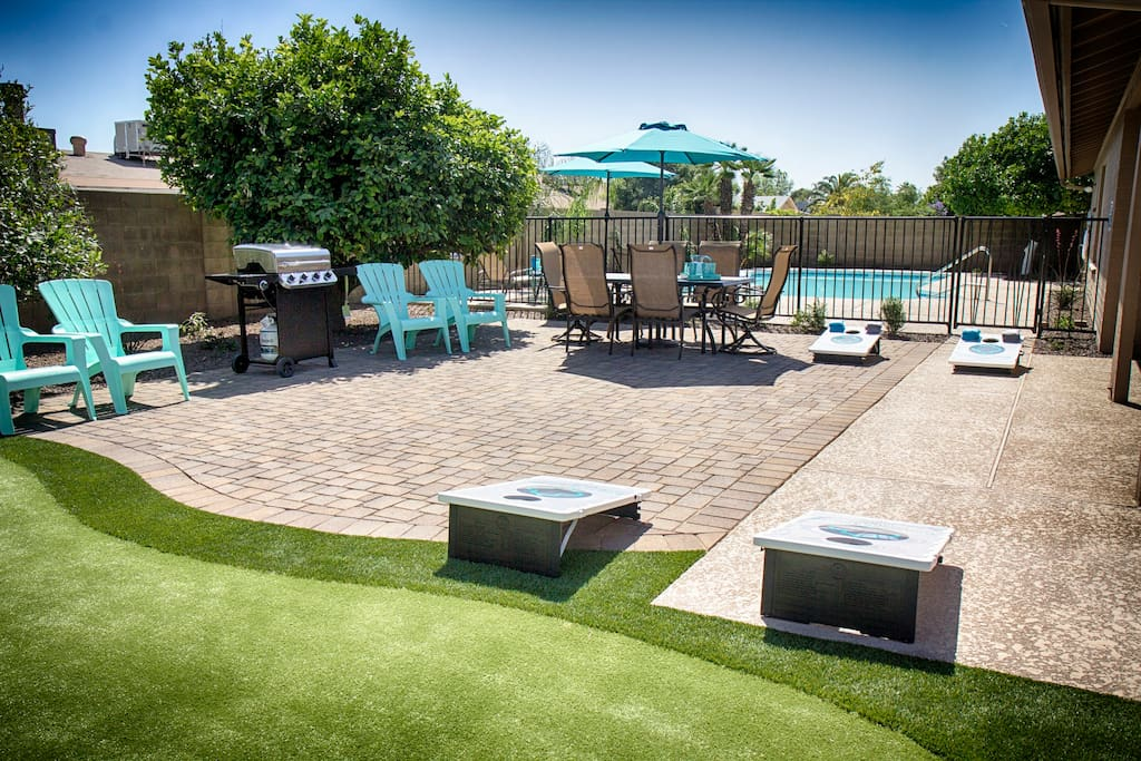 Fun backyard complete with putting green, bean bag toss, BBQ and pool!