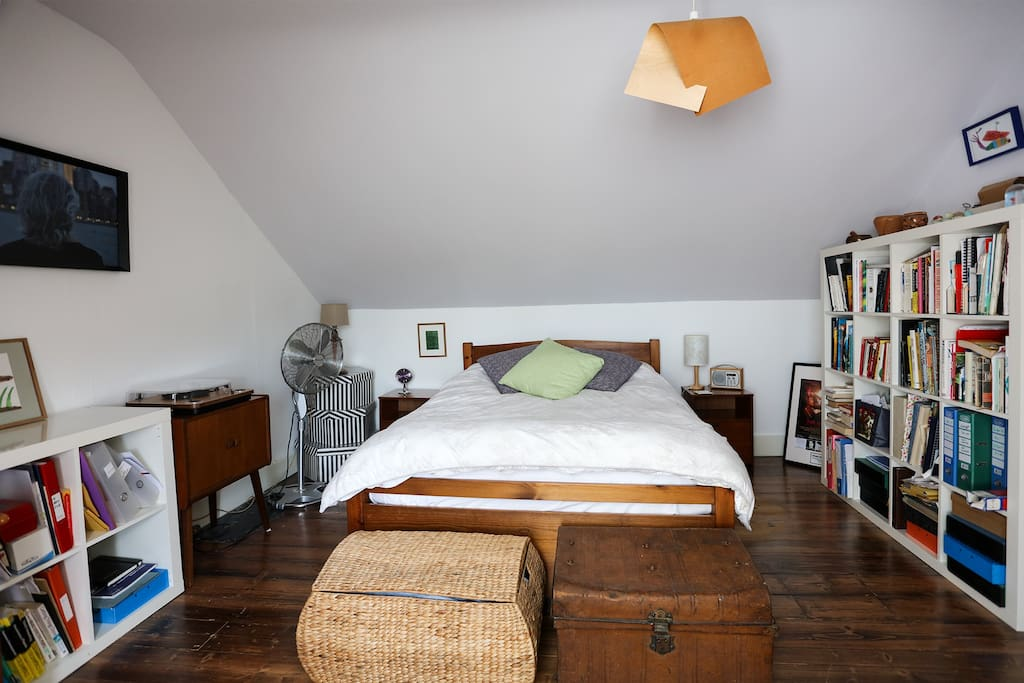 Comfortable double bed with wooden frame from Warren Evans