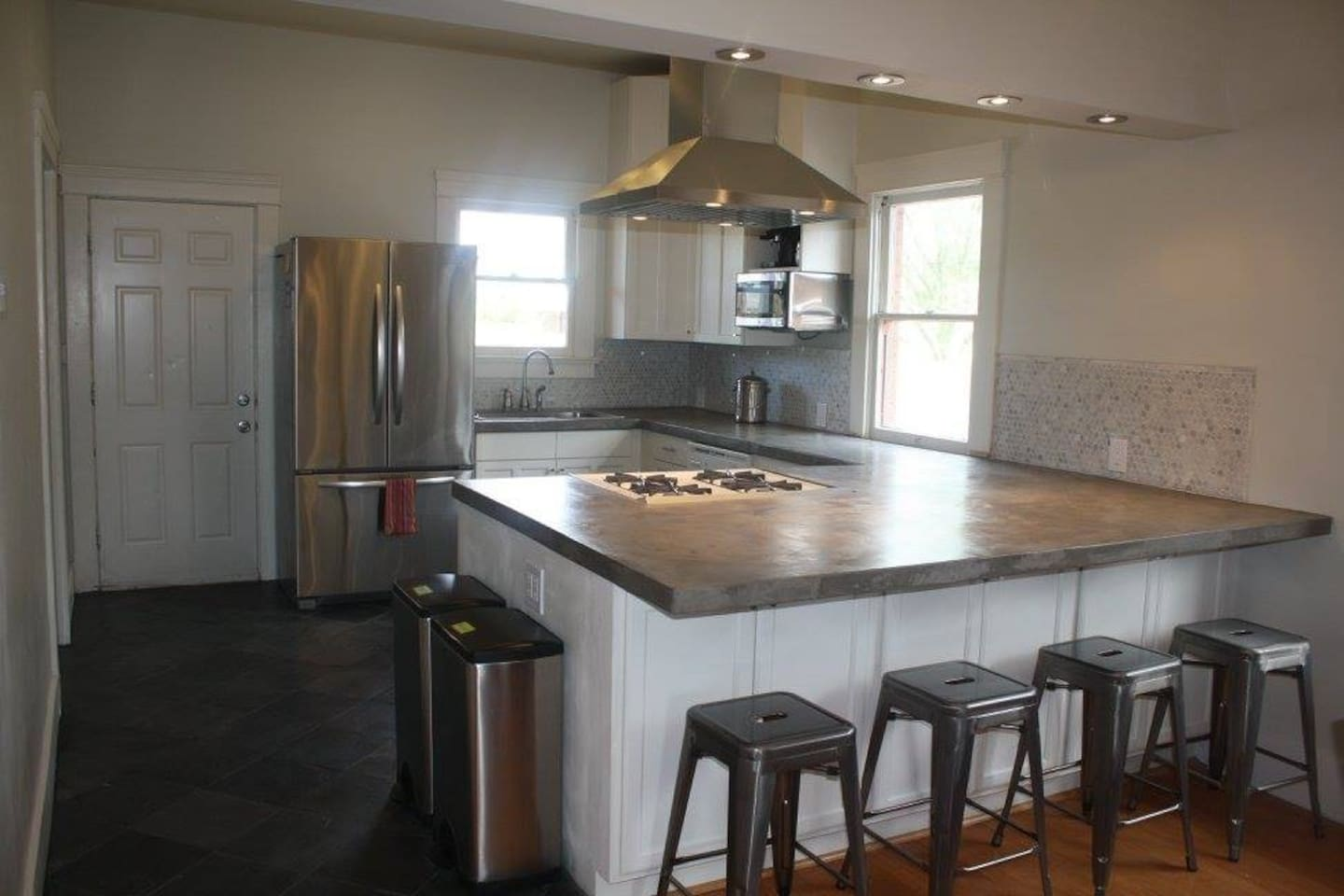 The kitchen opens up to the dining / living rooms.