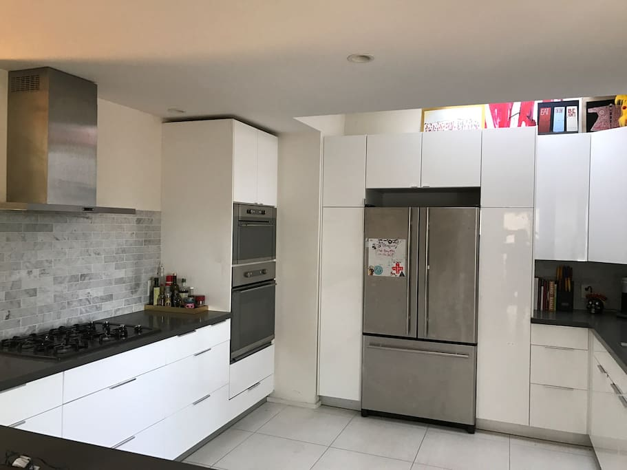 kitchen with all stainless steel appliances. oven, microwave, dishwasher,and  large fridge.