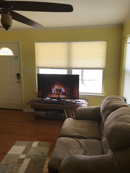TV and shorter couch in living room