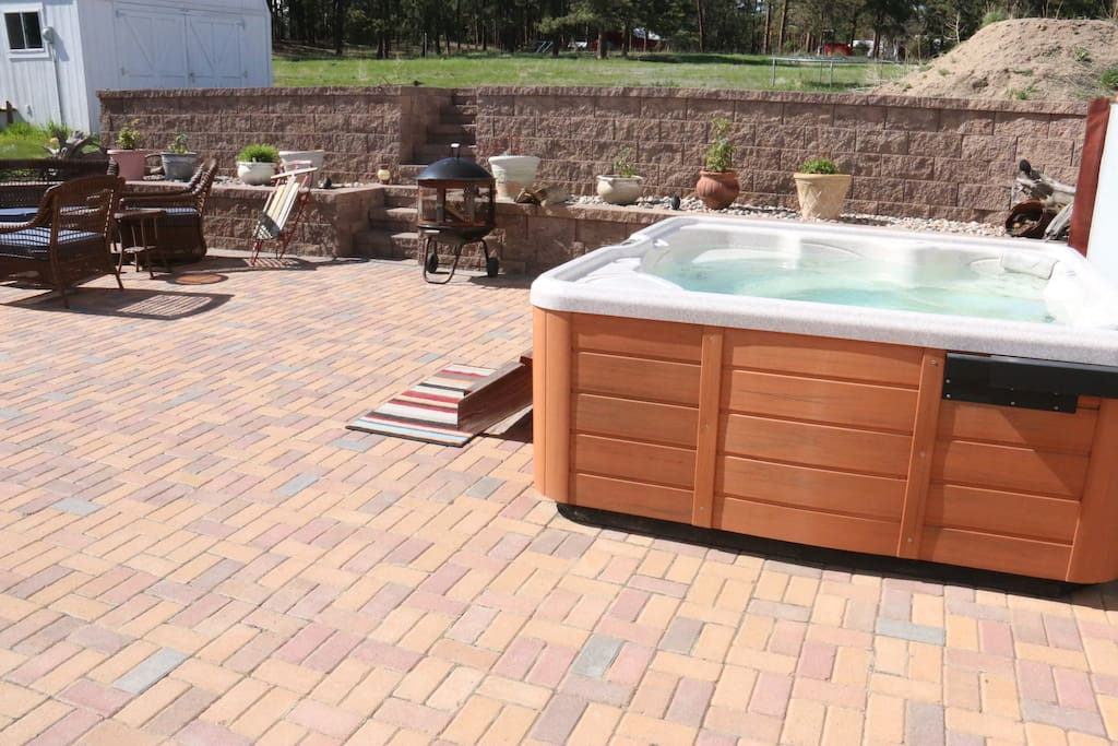 The 8 person hot tub on the large western brick patio.  A wonderful space for relaxing!