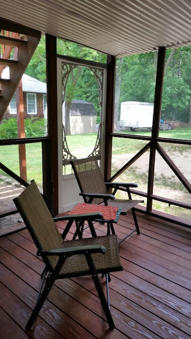 Screened in rear porch access through slider.
