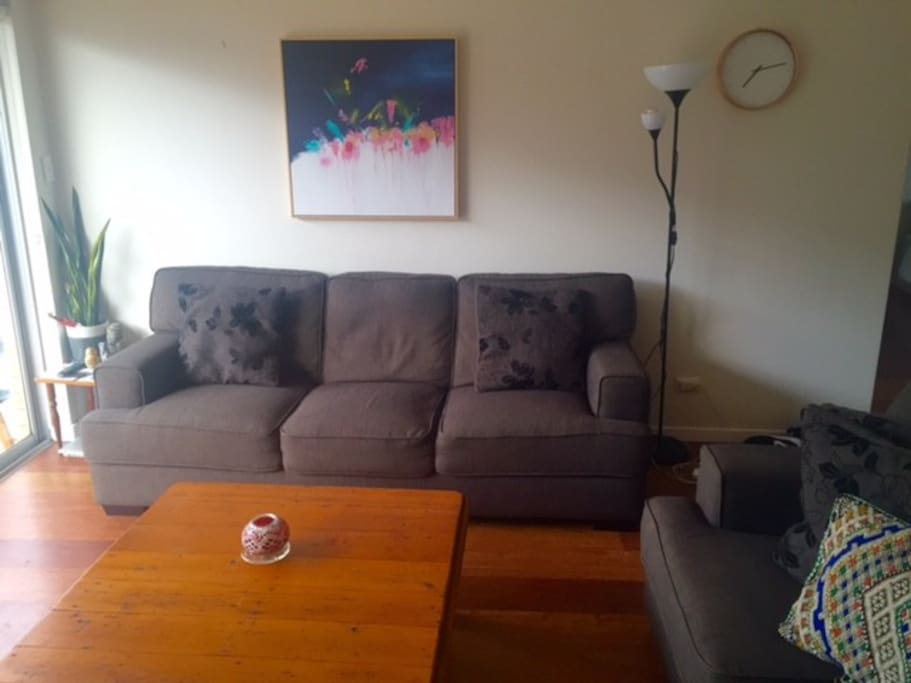 Large loungeroom with two comfy couches, tv and air-conditioning