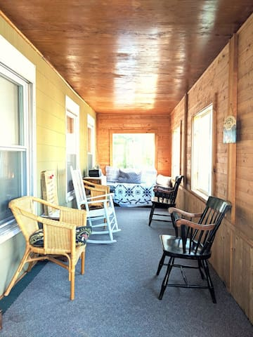 Front porch with lots of windows, perfect place to reflect on your time at the lake.
