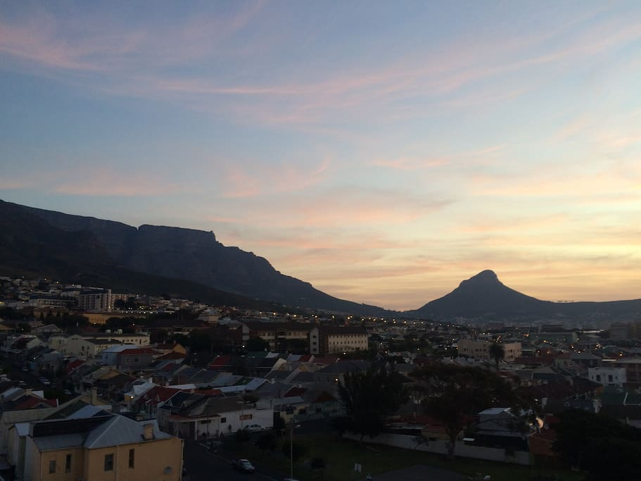 View of Lions Head, Table mountain and Woodstock from balcony.