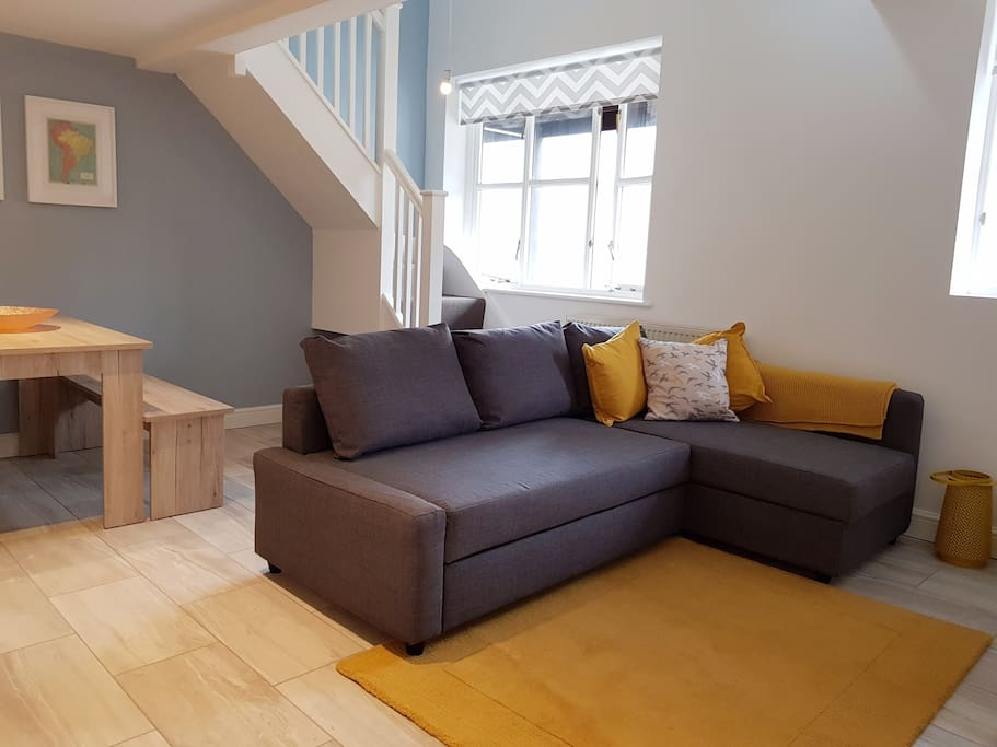 Sit back and relax on the large sofa. The base also rolls out to make a double bed.