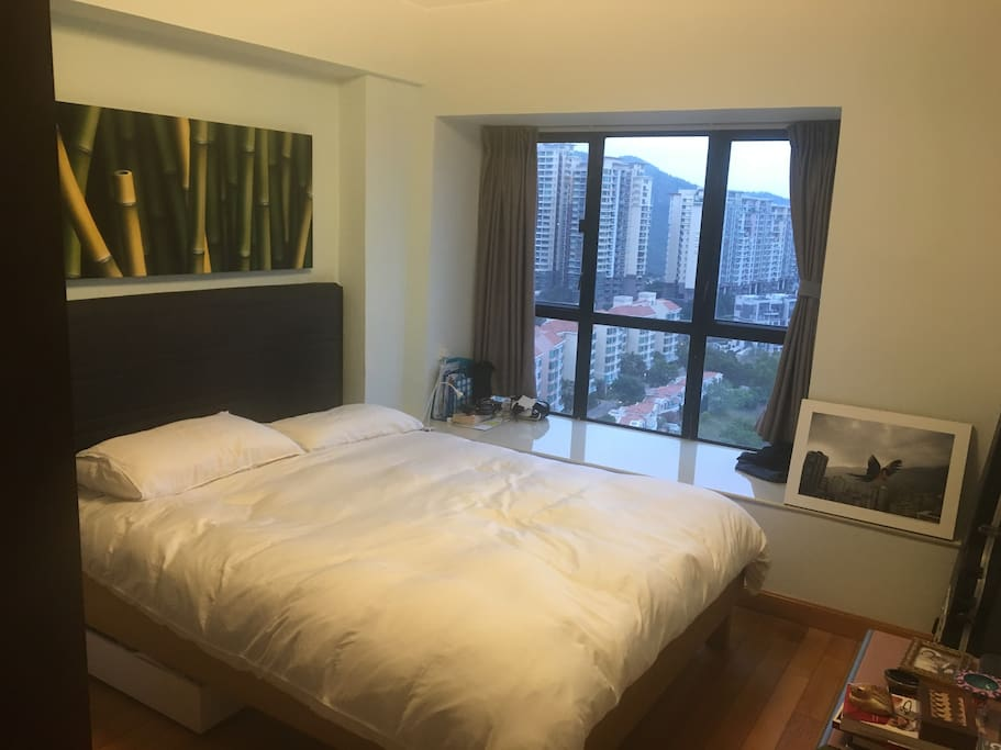 Master bedroom. Sleep with the twinkling lights of the Hong Kong skyline, wake up to the ships crossing the harbour!