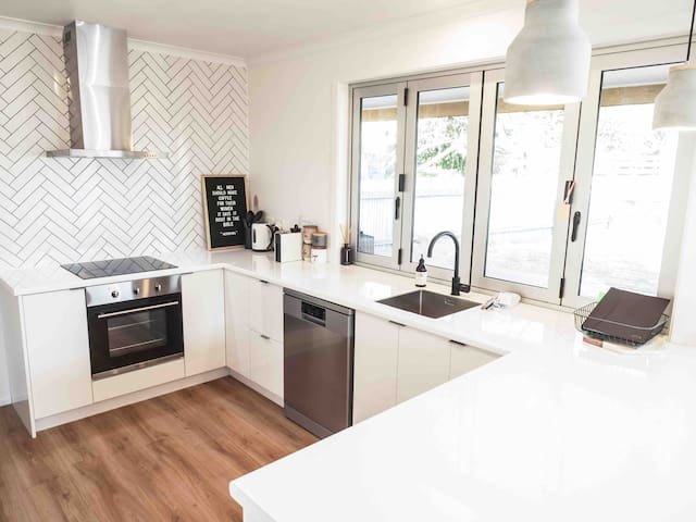 Kitchen with everything you need. Bifold window opens up to breakfast bar
