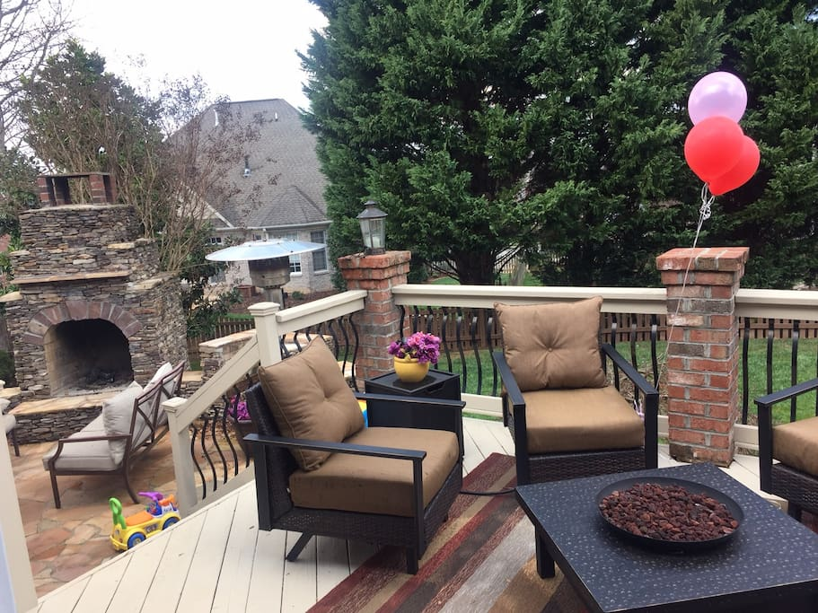 Large deck w/ fire pit overlooking a fenced in backyard.  Patio w/ Fireplace for more entertaining!