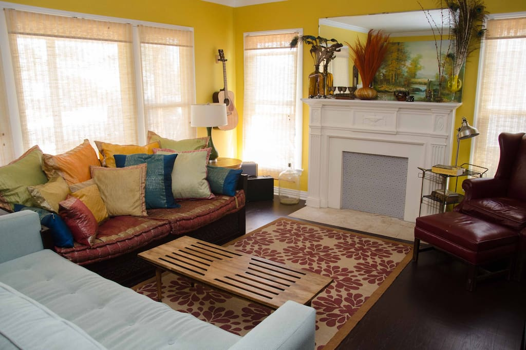 Relax (couches perfect for an afternoon snooze!) or read a book in our colorful living room.