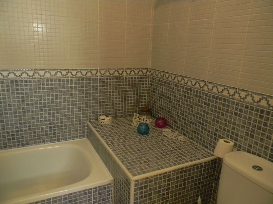 Large main bathroom... Boasts bath , and shower ... Very spacious and comfortable !