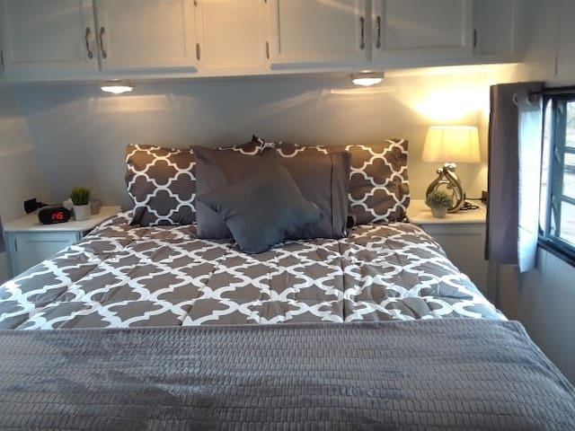 Queen pillowtop full size mattress this is not an rv short mattress.Alarm clock with a charging port for cell phone.