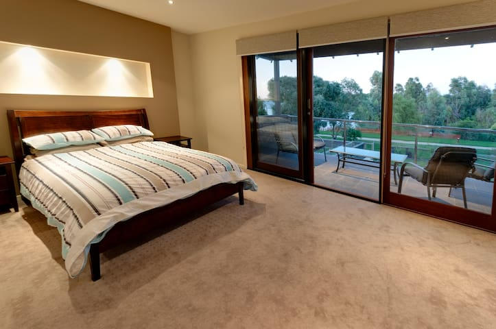 Main bedroom, overlooking pool and harbour. (Fold out sofa bed not shown)