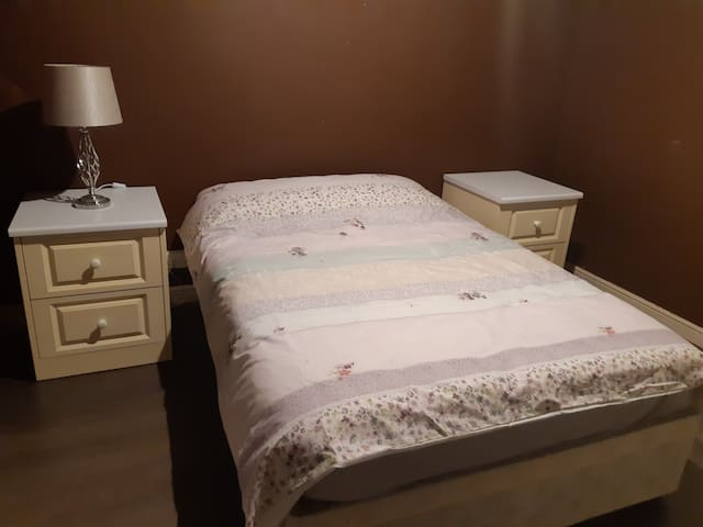 Double bed and deskside tables