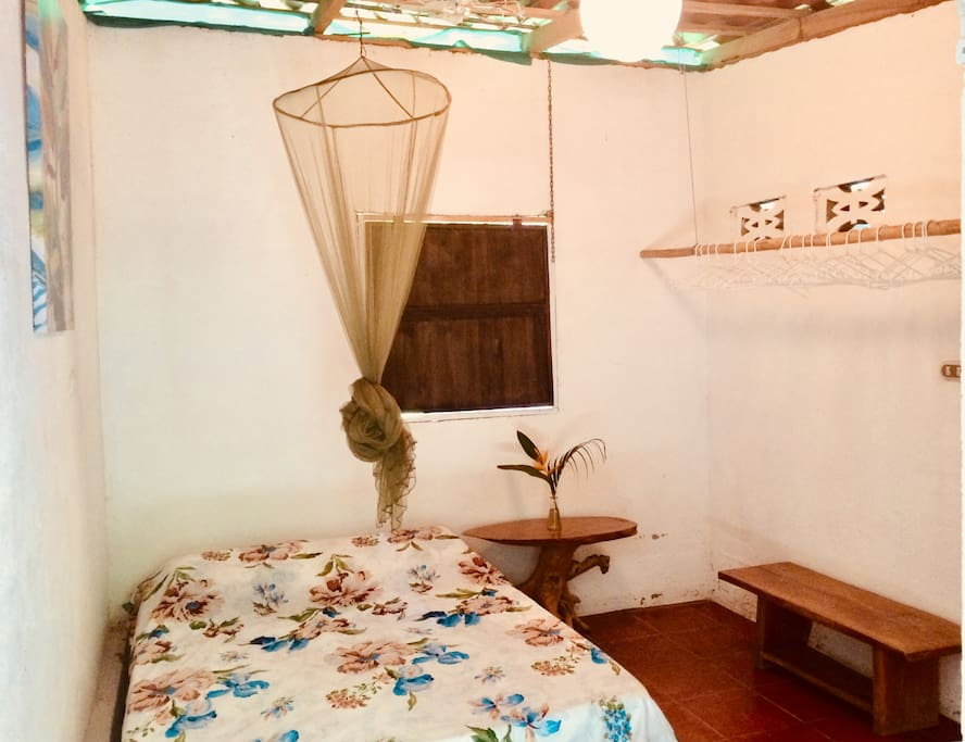 Bed, mosquito net and open closet