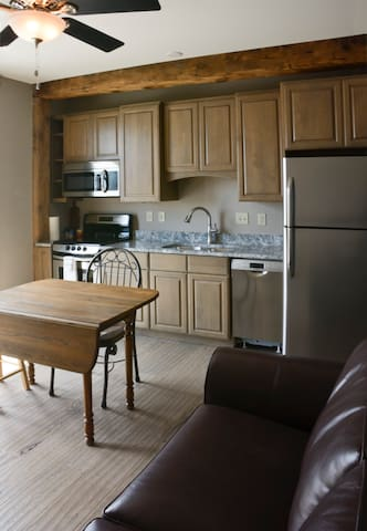 Fully equipped kitchen with fridge/sink/stove/oven/microwave