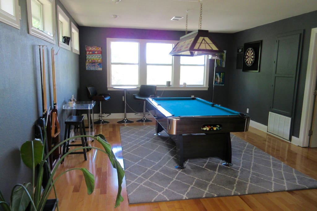 Swanky upstairs pool room with bar stools/bar table and incredible views of downtown.