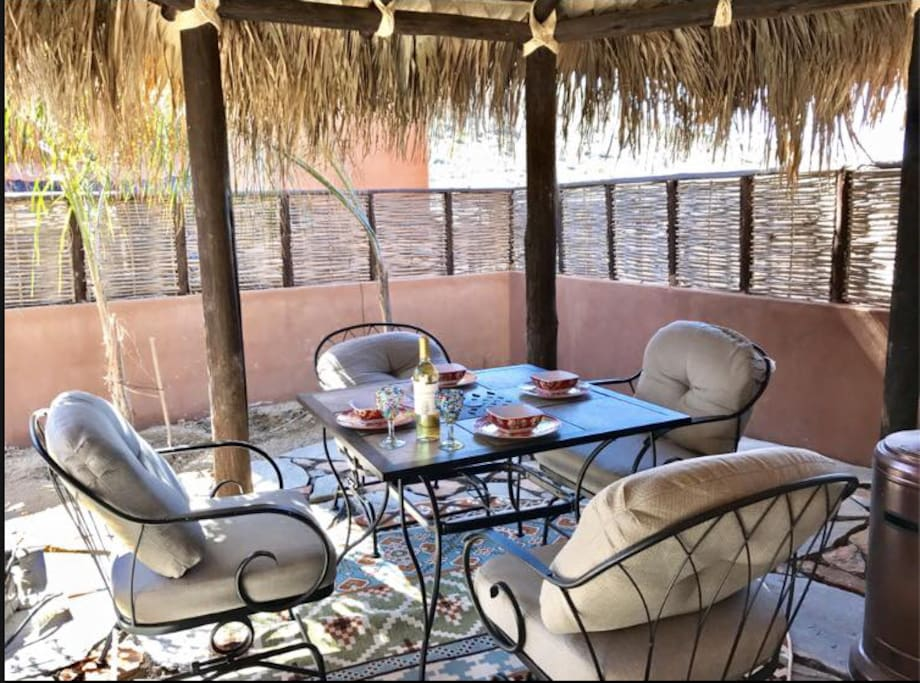 Outdoor palapa-covered dining area for 4.
