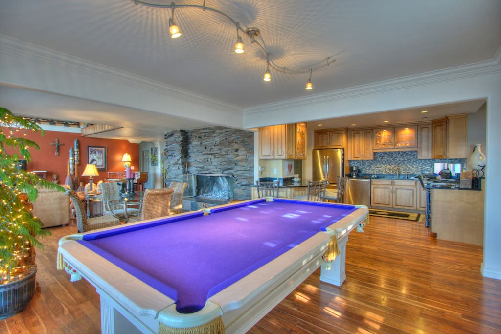Pool table off kitchen and living room.