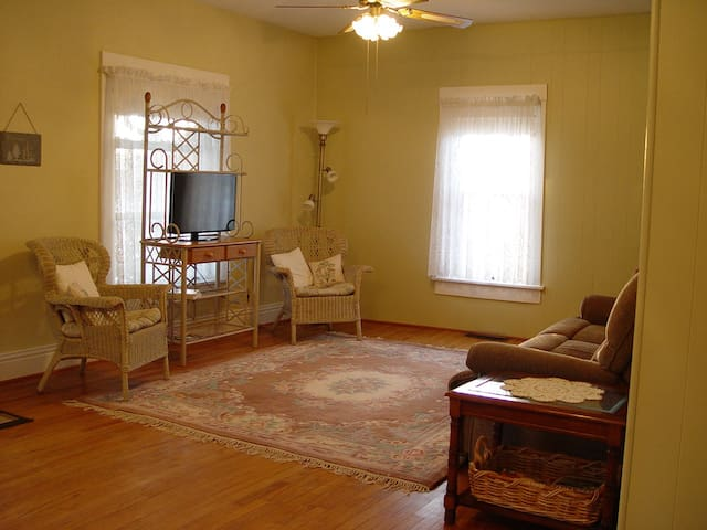 Wicker chairs and a reclining couch to watch TV or enjoy the company of friends and family.