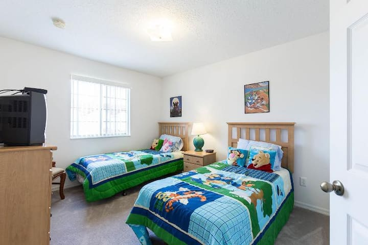 The Disney bedroom featuring twin (single) beds