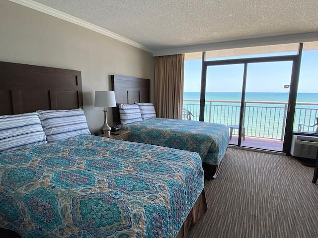 Open Air Arrival - WATCH THE DOLPHINS FROM YOUR BALCONY or THE WAVES FROM YOUR BED. Great FULL KITCHEN condo with Pools, Hot Tubs, Lazy Rive & MORE BAc