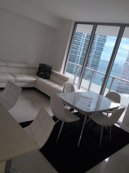 Living area with bay and city view