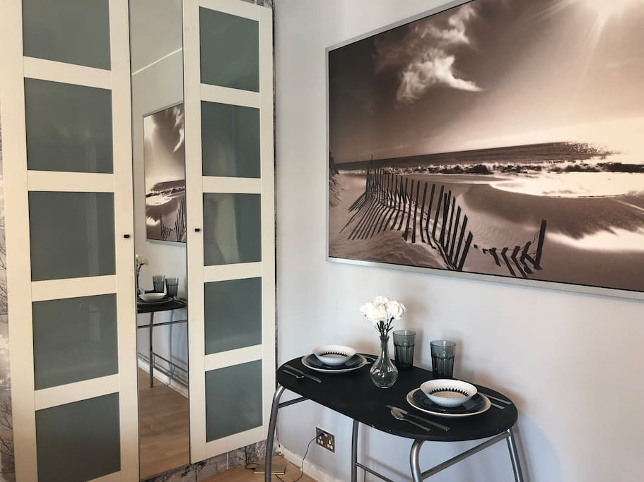 Dining table for two and double door wardrobe