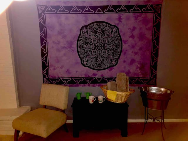 bath towels • coffee mugs • cacti water cups • sitting area next to fireplace