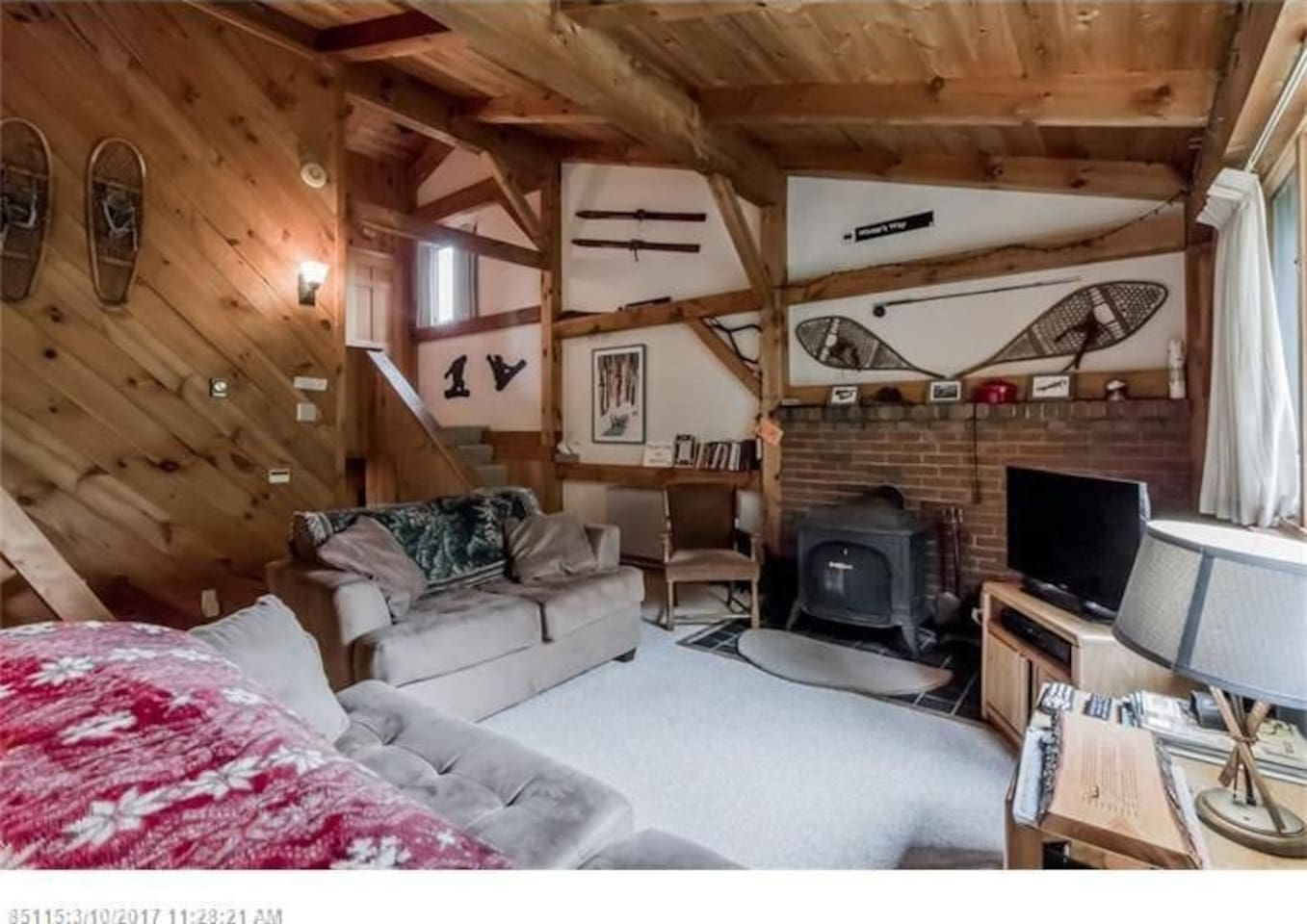 Cozy, spacious great room with an open floor plan and toasty wood stove!