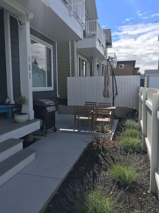 Patio space with privacy fence, BBQ,  umbrella and table