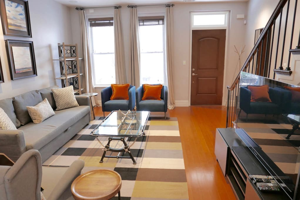 """Living Room/Den with 60"""" cable TV + sleeper sofa"""