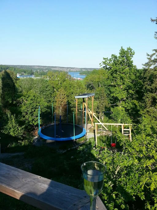 View from eastside veranda. Garden with trampoline, swingset.