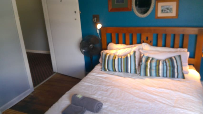 The bedroom is Clean, repainted, new mattress and bedding, lamps and Wall mounted TV