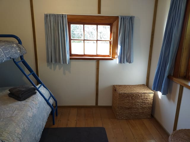 #2 bedroom opens into lounge area, with curtains to block off
