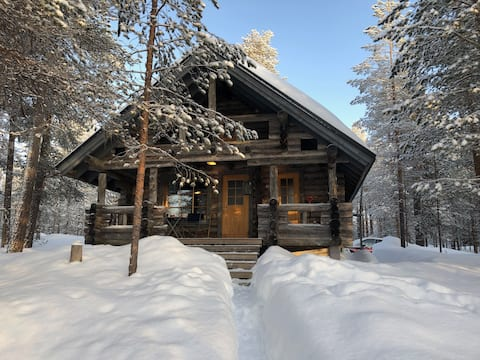 Idyllic log wood cabin in Hossa with private pond