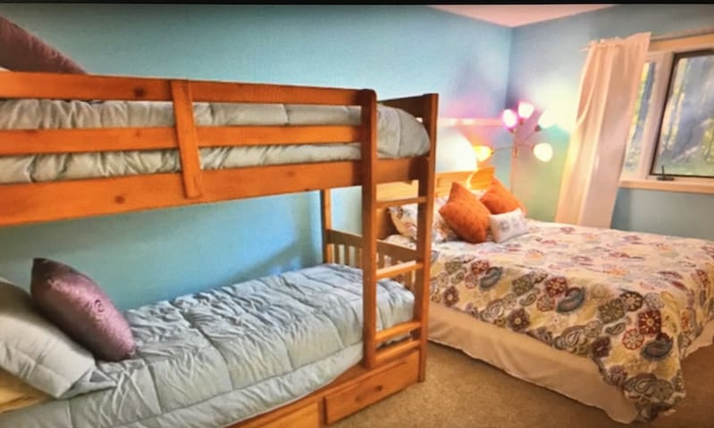 2nd Bedroom includes Queen Bed and set of Bunks