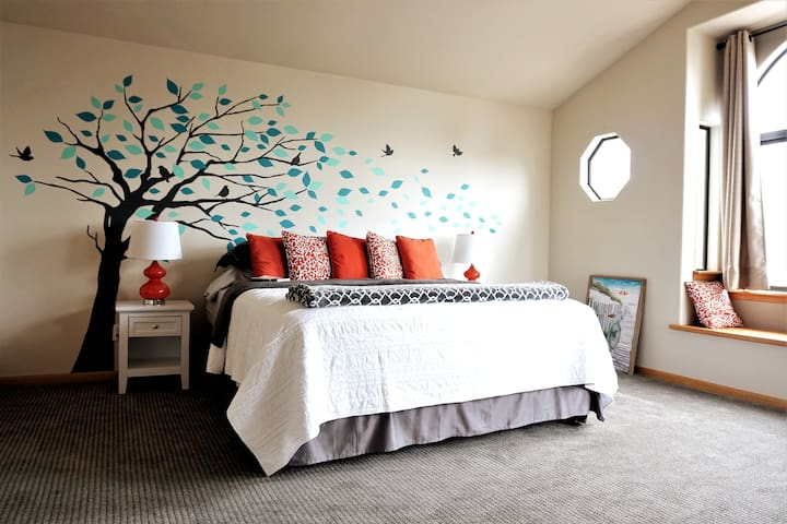 The master suite located on the top floor boasts ocean views, a king size bed, a walk-in closet, and a master bath.