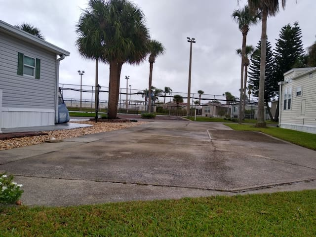 Picture taken from the back of the RV pad notice how close the tennis courts are and the swimming pool next to that.