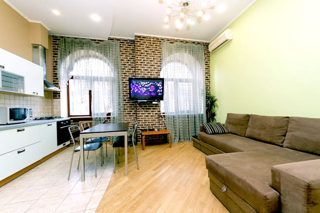 Very spacious living room overlooking the central Basseynaya Street, combined with a kitchen area, comfortable corner sofa bed can be used as an extra bed.