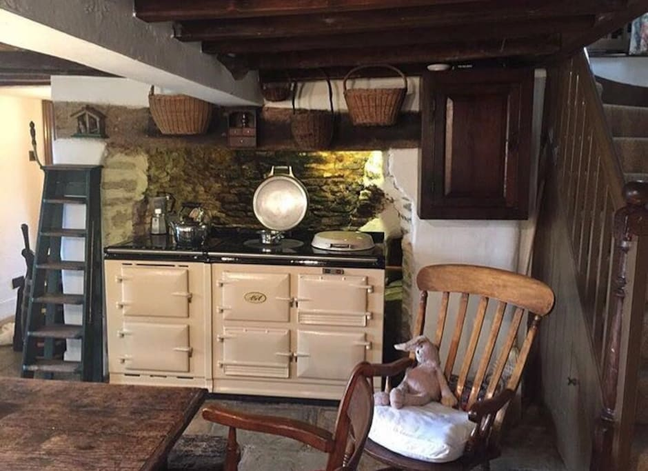 The kitchen has an electric Aga and stone flagged floor