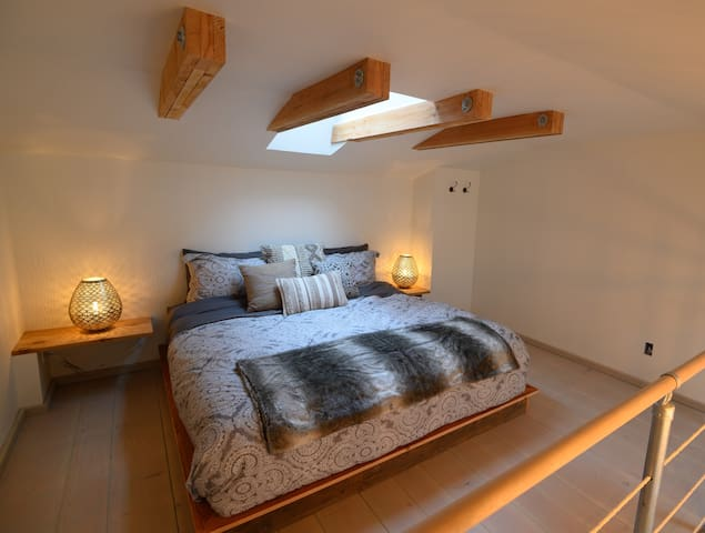 Luxurious king sized bed in 6 foot 2 inch ceiling loft.
