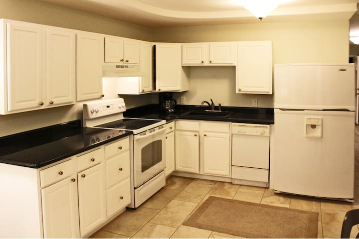 Cozy kitchen area features granite countertops and White Appliances with Electric Range.  Small Appliances will include Coffee Maker, Toaster, and Blender.