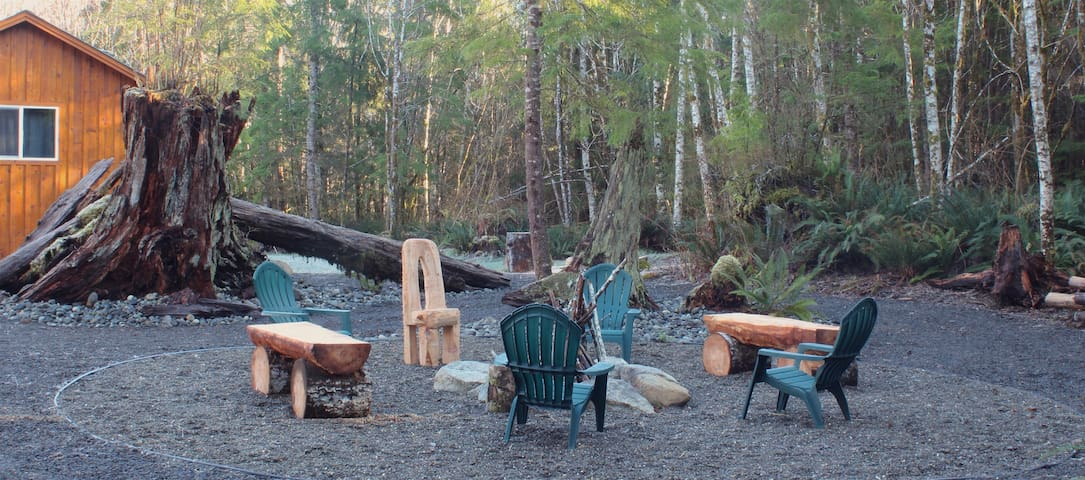Have a night out by the fire pit. Benches and chairs hand carved by the owner himself.