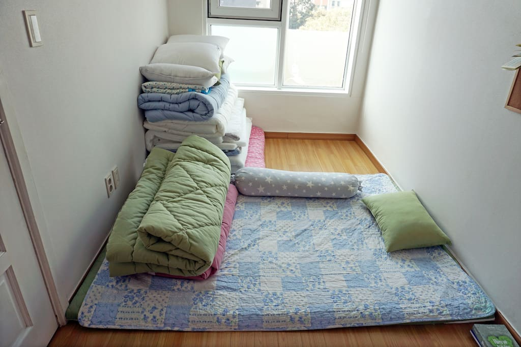 The bedroom has 3 folding type bedding sets (queen size).