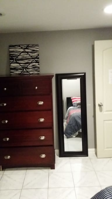 Spacious 5 drawer dresser to keep clothes well organized and a full size mirror.